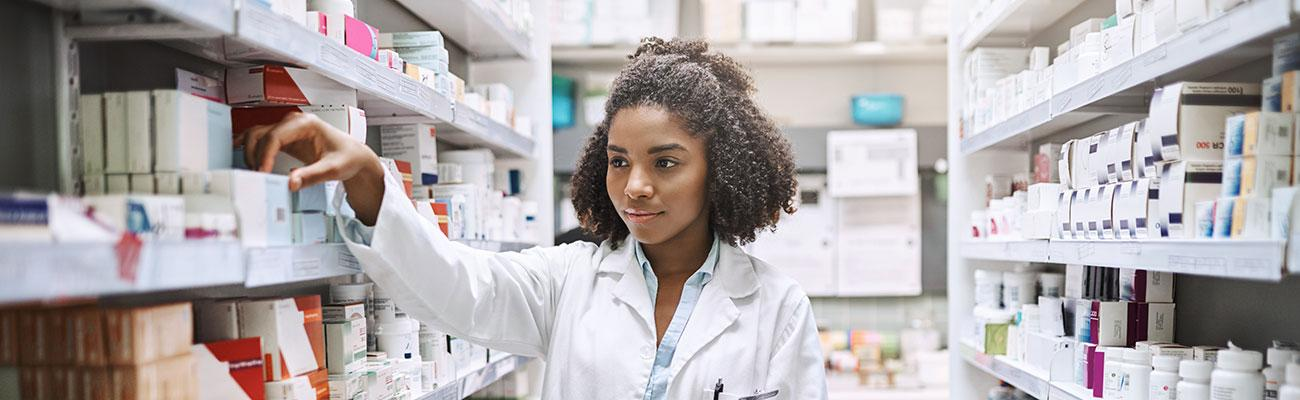 A female pharmacist in a stockroom.