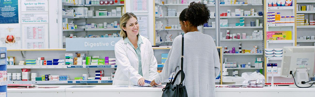 A female pharmacist with a female patient.