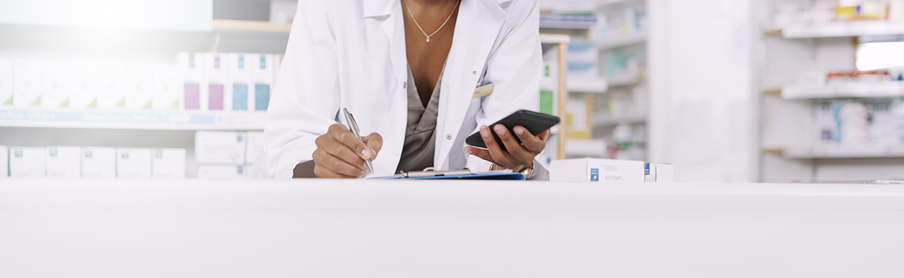 Pharmacist with a cellphone.