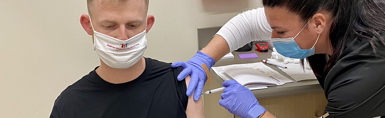 A healthcare worker giving a vaccine