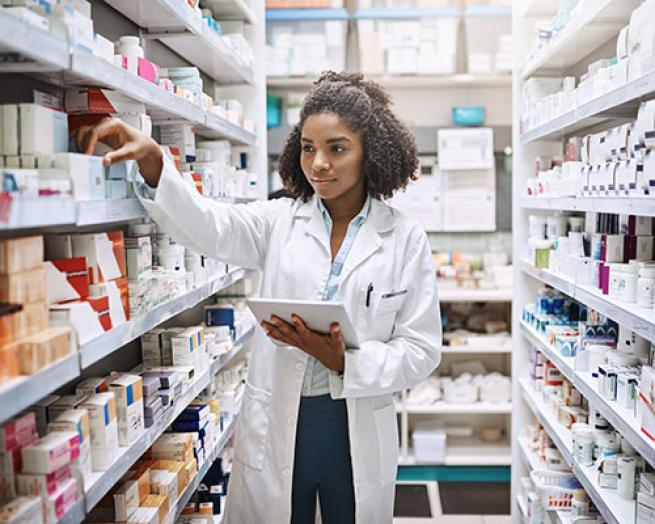 Female pharmacist in stock room.
