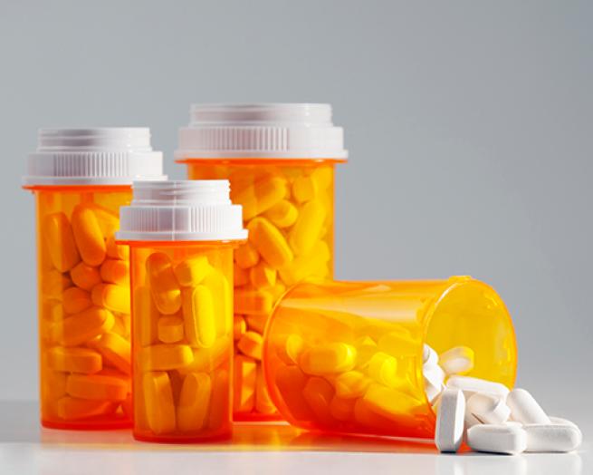 Various pill bottle with white pills.