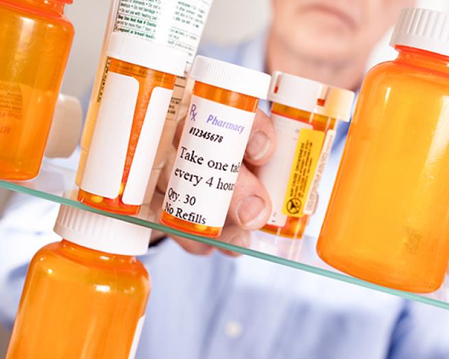 Pill bottles on a pharmacy shelf.