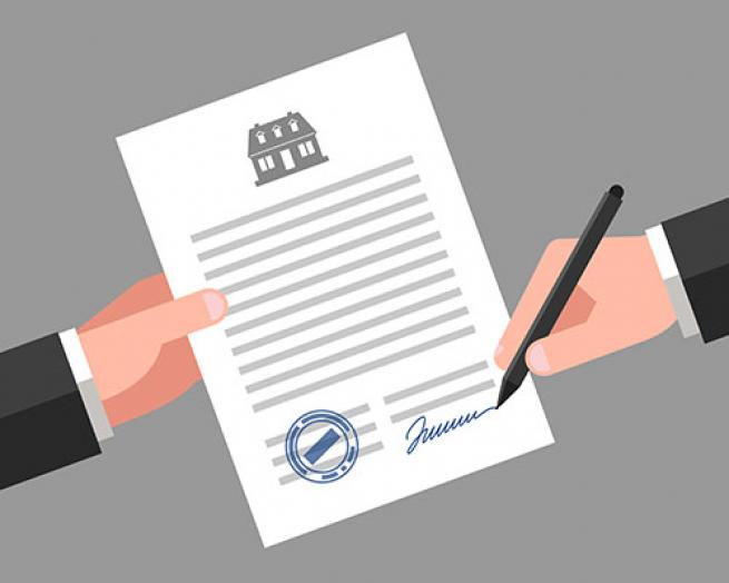 A hand holding a document and another hand signing it with a pen