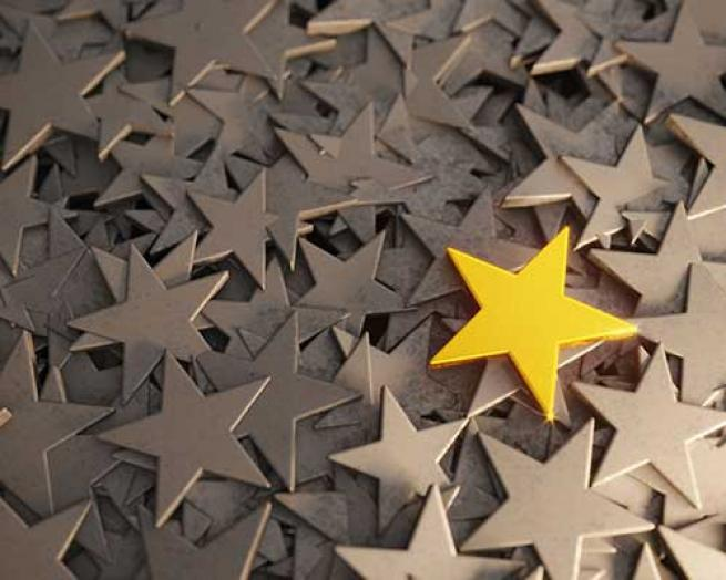 A gold star among white stars.