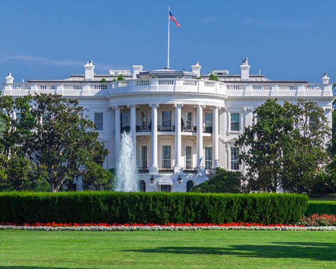 a large building with White House in the background