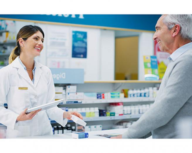 Pharmacist with a patient.
