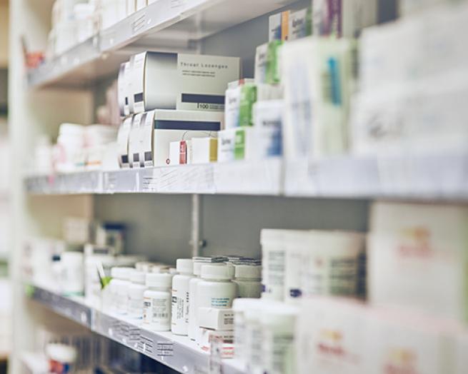 A pharmacy shelf with medications.