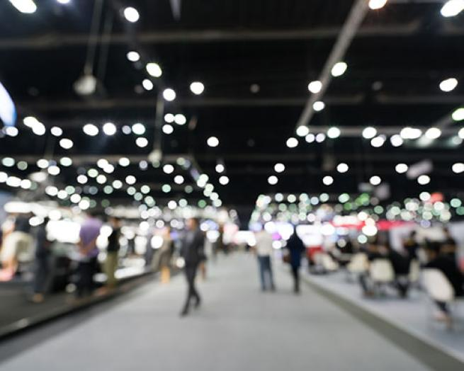 People walking at an exhibit hall.