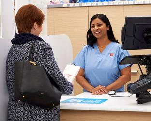 Walgreens pharmacist with patient