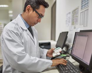 pharmacist using a computer