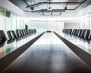 A boardroom with empty chairs.