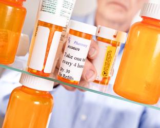 Pill bottles in a medicine cabinet.