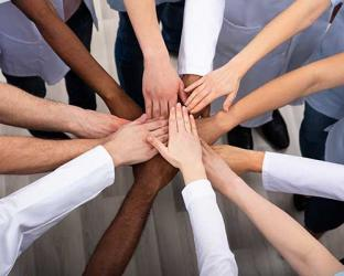 People of different races holding hands.