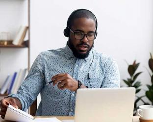 A man at a laptop.