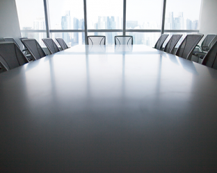 A boardroom with empty seats.