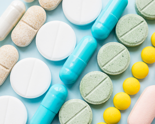 Different colored pills and tablets.