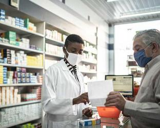 a pharmacist with a patient.
