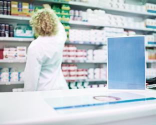 A female pharmacist in a stockroom.