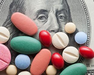 Colored pills on the face on money.