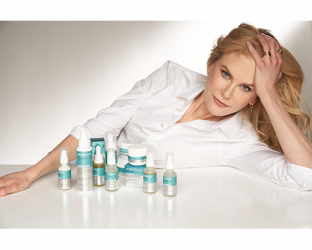 Nicole Kidman lying on a bed
