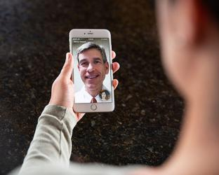 A person having a video visit on cell phone.