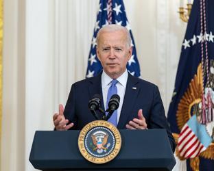 Joe Biden wearing a suit and tie