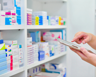 A pharmacy stock room and a person holding a pad