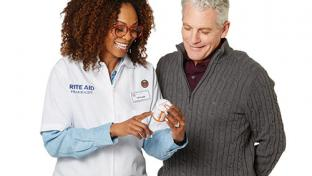 Rite Aid pharmacist with patient