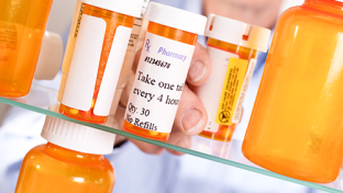 A medicine cabinet with pill bottles.